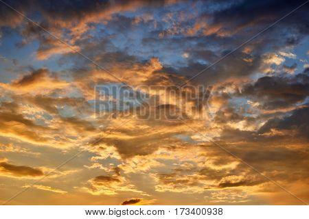 Sunset sky, beautiful clouds, bright orange and dark blue colors.