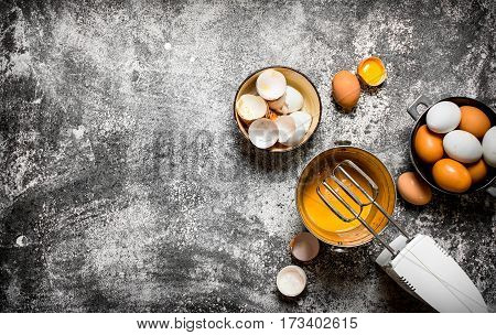 Dough Background. Preparation Of The Dough. Whisking Fresh Eggs In The Bucket Mixer. On Rustic Backg