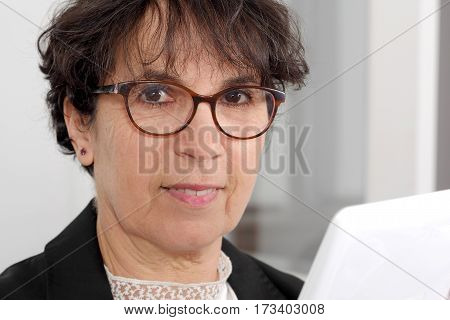 portrait of a brunette mature woman with glasses