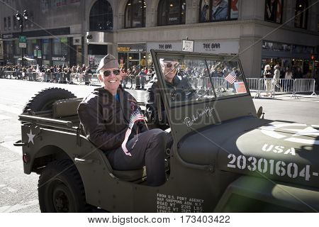 NEW YORK - NOV 11, 2016: Vets ride in a classic vintage Jeep parade vehicle during the 2016 America's Parade on Veterans Day in New York City on November 11, 2016.