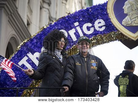 NEW YORK - 11 NOV 2016: Vets ride on the Military Order of the Purple Heart parade float in the annual Americas Parade up 5th Avenue on Veterans Day in Manhattan.