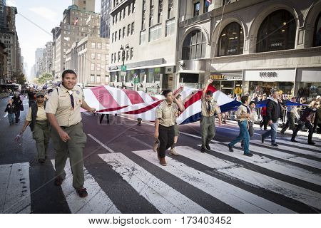 NEW YORK - 11 NOV 2016: Members from Boy Scouts of America carry a large American Flag in the annual Americas Parade up 5th Avenue on Veterans Day in Manhattan.