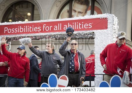 NEW YORK - 11 NOV 2016: Vets wave from the Aetna parade float in the annual Americas Parade up 5th Avenue on Veterans Day in Manhattan.