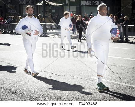 NEW YORK - 11 NOV 2016: Vets in white fencing uniforms with foils and masks march in Americas Parade up 5th Avenue on Veterans Day in Manhattan.