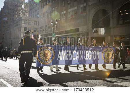 NEW YORK - 11 NOV 2016: Vets from the American Legion carry the banner while marching in Americas Parade up 5th Avenue on Veterans Day in Manhattan.