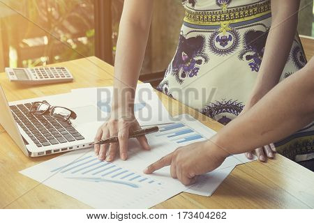The above view of business meeting dicuss financial data vintage tone