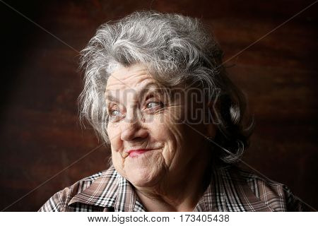 Happy granny face on a dark background