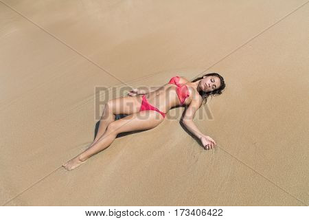 Attractive Young Caucasian Woman In Swimsuit Lying On Beach Top View, Girl Wet Sand Sea Ocean Holiday Summer Vacation