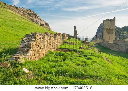 Ruins of ancient Genoese fortress in Sudak Crimea Ukraine - evening photograph.