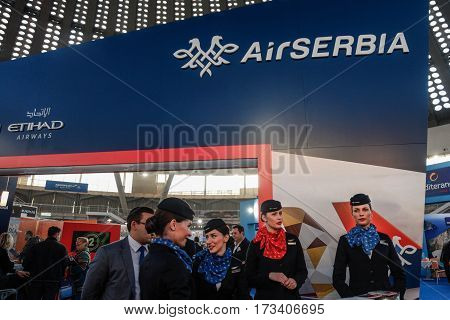 BELGRADE SERBIA - FEBRUARY 25 2017: Air Serbia staff posing on the carrier's stand during the 2017 Belgrade Tourism fair