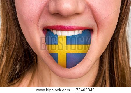 Woman With Swedish Flag On The Tongue