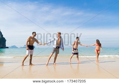 Two Couple On Beach Summer Vacation, Young People In Love Walking, Man Woman Holding Hands Sea Ocean Holiday Travel