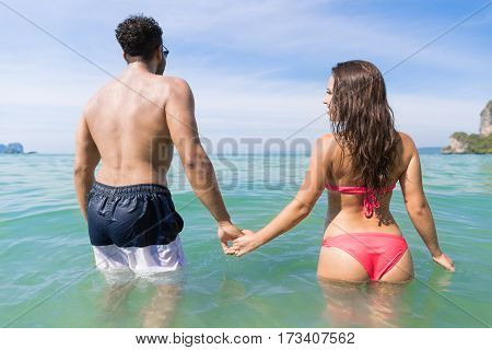 Couple On Beach Summer Vacation, Young People In Water , Man Woman Holding Hands Sea Ocean Holiday Travel