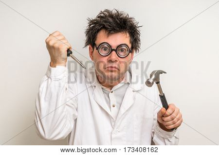Crazy Scientist With Hammer And Screwdriver