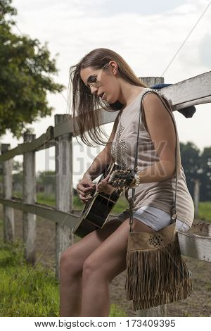 The Beautiful Girl With A Guitar In The Countryside