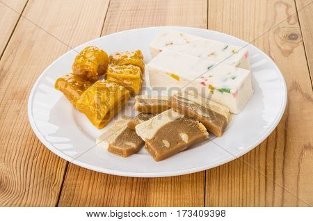 Oriental Sweets In Dish On Wooden Table