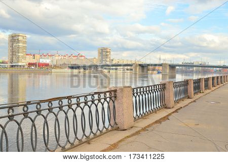 Volodarsky Bridge and fence on the embankment of the Neva River in St.Petersburg at cloud spring day Russia.