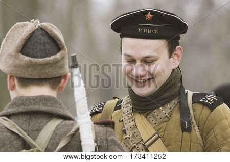 The park Ekaterinhof St. Petersburg (Russia) - February 23 2017: Military historical reconstruction of events of World War II. Widely smiling young Soviet sailor of the Baltic Fleet with Flotilla Leader