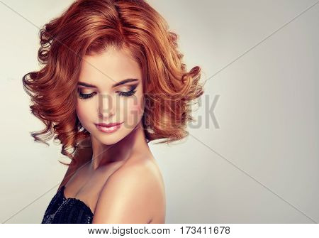 Beautiful model girl with curly hair .Young woman with short wavy hairstyle