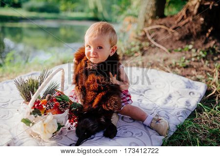 Child having picnic in park - shallow depth of field.