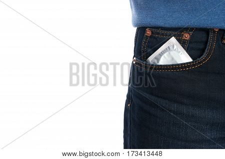 Condom in a pocket man jeans isolated on white background with copy space. Safe sex concept.