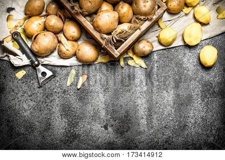 The Peeled Potatoes With An Old Wooden Box. On Rustic Background.