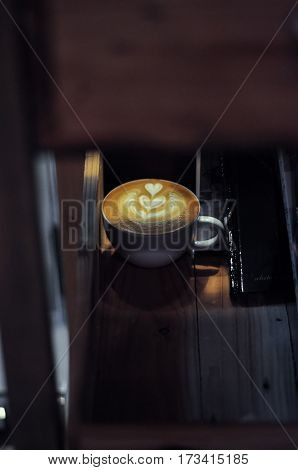Latte Art At Night In The Wooden Tray