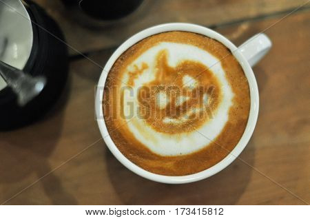 Coffee Cup With Halloween Latte Art On The Wood Table