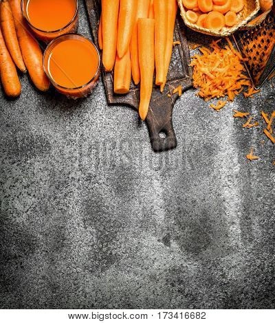 Fresh Carrot Juice. On Rustic Background.