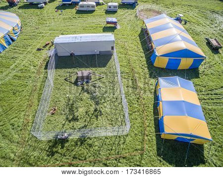 Aerial view of a circus tent with cage of white tigers