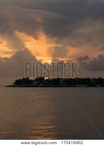 Beautiful Sunset with Clouds on the Inlet with Homes in Key West Florida