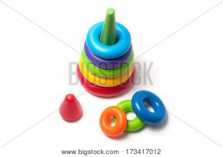Children's multi-colored rainbow toy pyramid isolated on white background