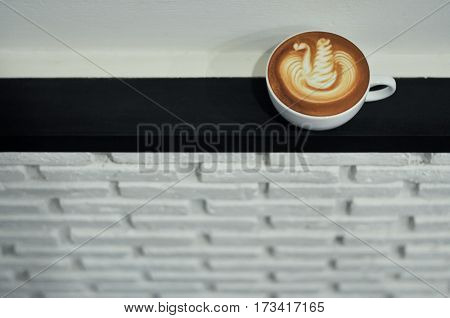 Coffee Cup With Latte Art Swan Pattern On The Wall Ridge