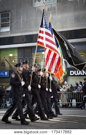 NEW YORK - 11 NOV 2016: Presentation of Colors by the NYPD honor guard march in the annual Americas Parade up 5th Avenue on Veterans Day in Manhattan.
