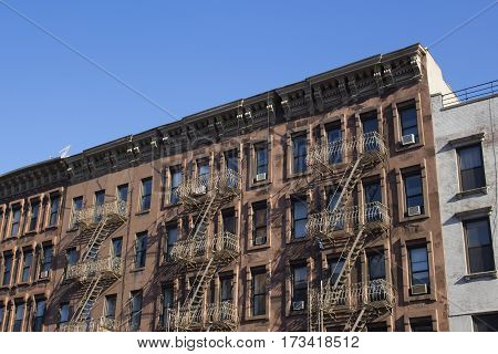 brownstone architecture with fire stairs in new york city
