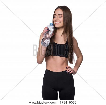 Positive Female Fitness Model After Workout Holding A Bottle Of Pure Water Over White Background.