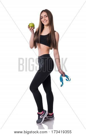 Slim And Healthy Young Woman Holding Measure Tape And Apple Isolated On White Background. Weight Los