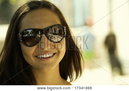 urban woman (special yellow toned photo f/x, focus point on smile and sunglasses)