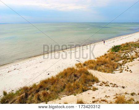 Joyful girl on South Beach Hel spit in Poland.