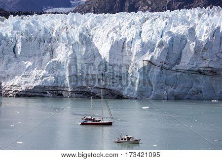 Two small boats exploring glacier in Glacier Bay national park in Alaska.