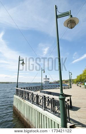 Lampposts on a wooden promenade in Sydney town (Nova Scotia Canada).
