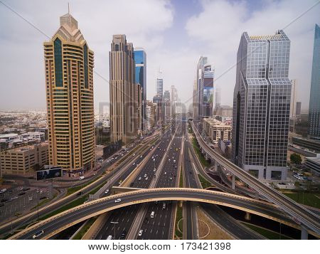 the landscape displays the traits of a modern metropolis with its fast movement. This and the road with cars and riding the train along the viaduct and skyscrapers stretching to the horizon
