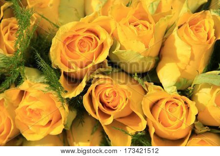 Yellow roses in a floral wedding arrangement