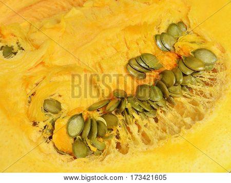 Orange pumpkin pulp with green seeds healthy organic fresh natural ingridient