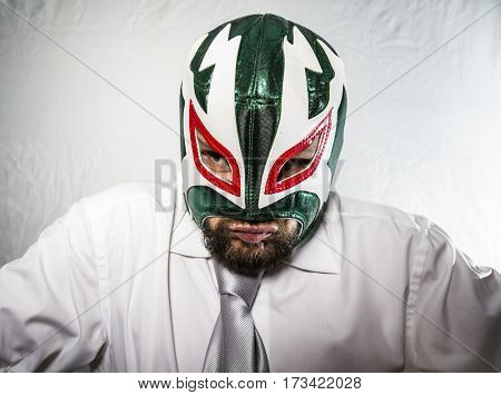 Fury, Angry businessman with iron mask on his face, is dressed in suit and tie poster