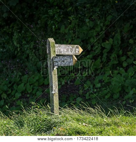old wooden signpost for backpackers. Lynmouth. North Devon. UK