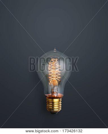 Light Bulb Glowing On Dark Grey Background Creative Ideas Background Concept.