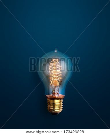 Light Bulb Glowing On Blue Background Creative Ideas Background Concept.