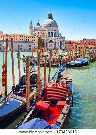 Gondolas On Canal Grande With Basilica Di Santa Maria Della Salute In The Background In Venice, Ital
