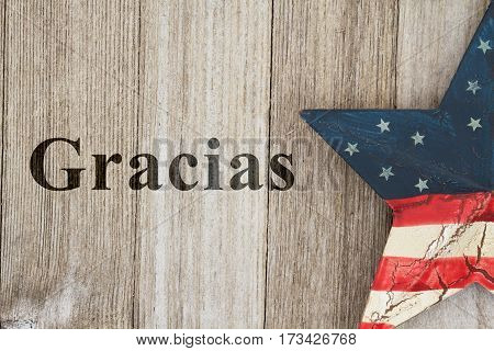 USA Spanish thank you message USA patriotic old flag on a stars with weathered wood background with text Gracias